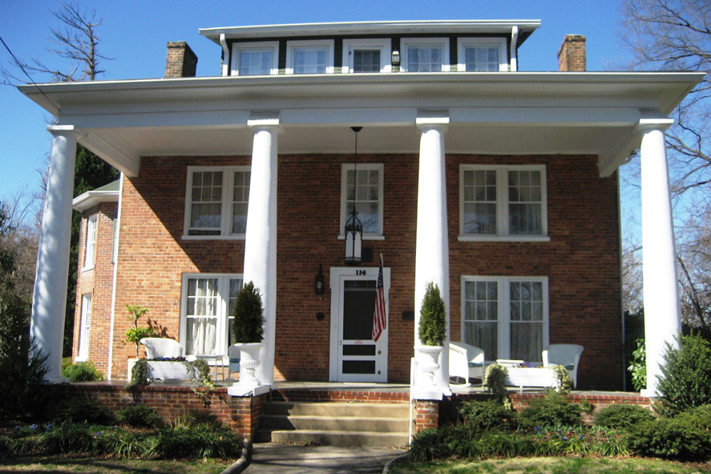 Large two-story brick home with imposing white columns
