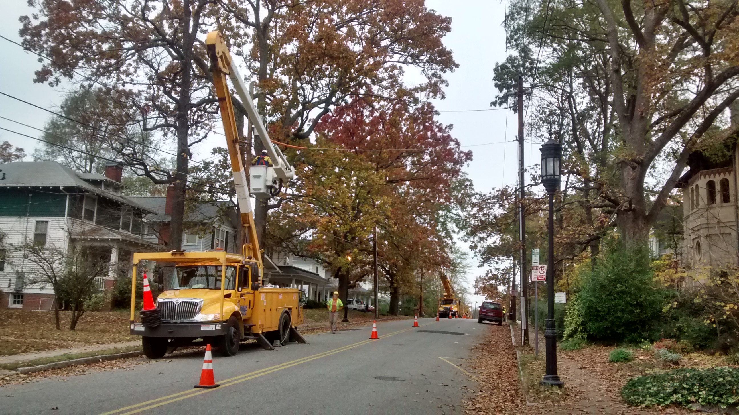 Two crews of workers install new streetlights