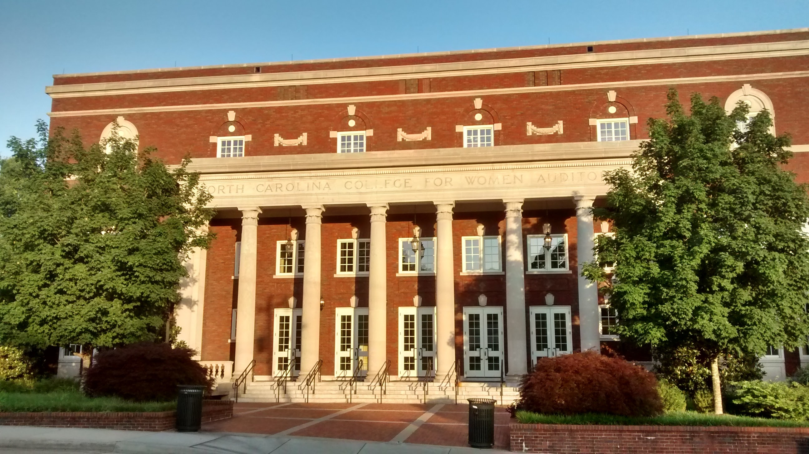 "Where the former Aycock Auditorium sign was, the original name appears: ""North Carolina College for Women Auditorium"""