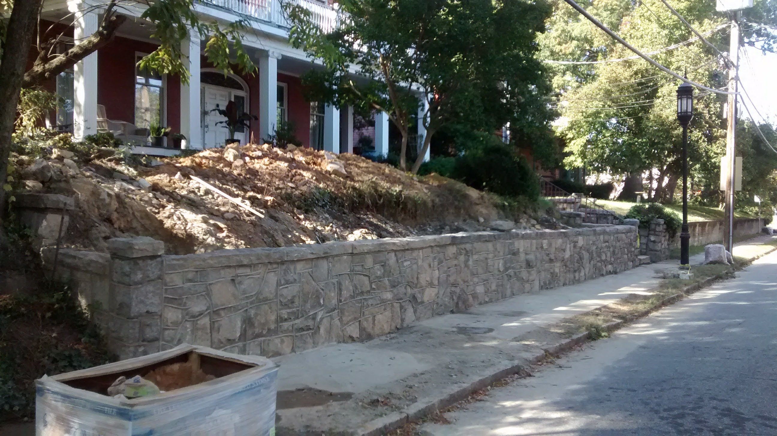 rebuilt wall at 110 south mendenhall, seen from the street