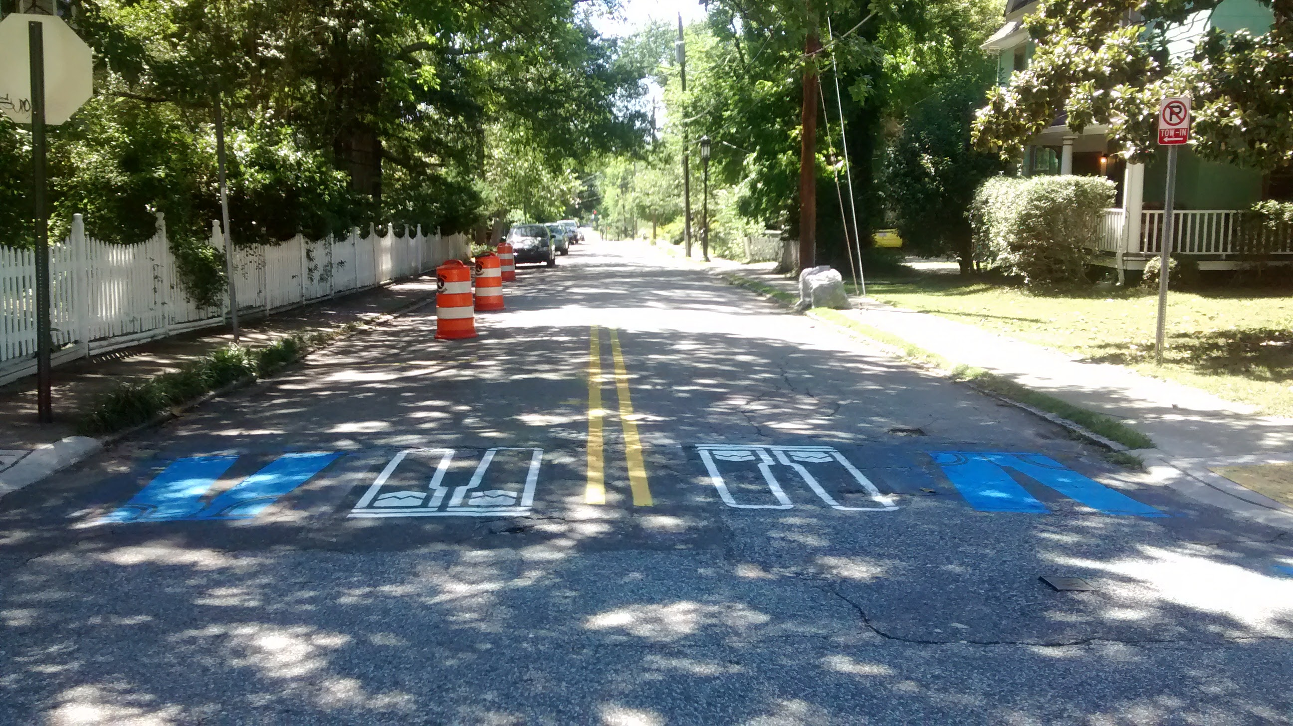Crosswalk formed by stencils of blue jeans