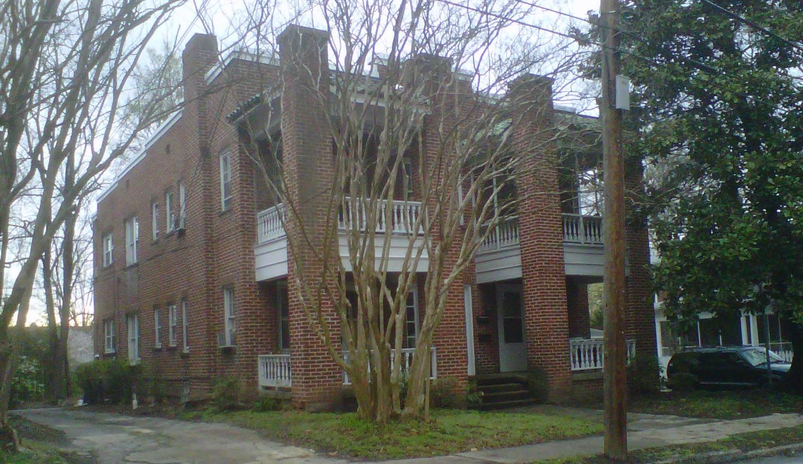 four-unit brick apartment house at 406 s. mendenhall street