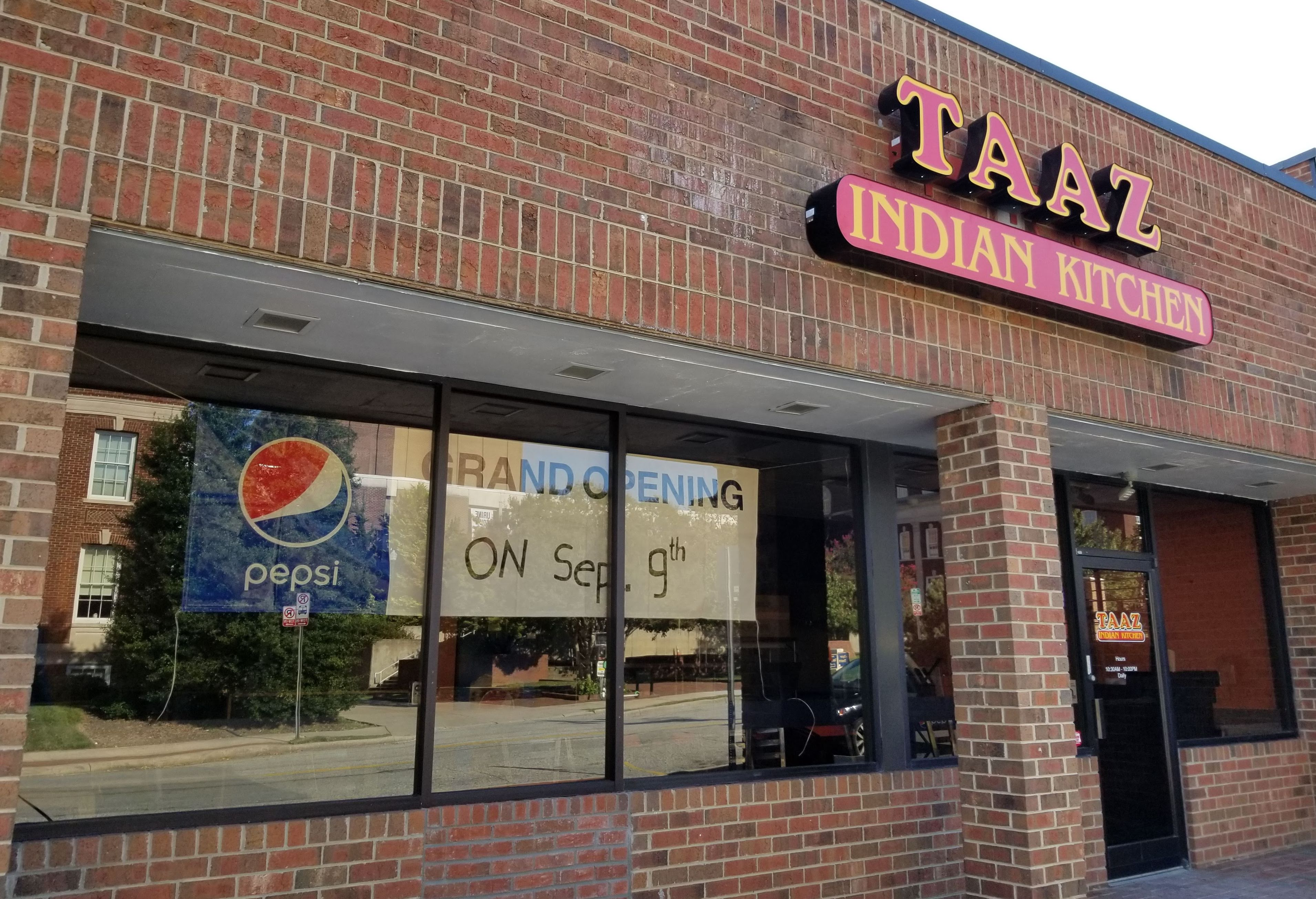 view from sidewalk of taaz indian kitchen