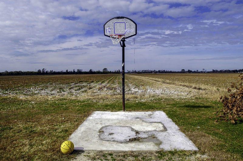small basketball court in a farm field