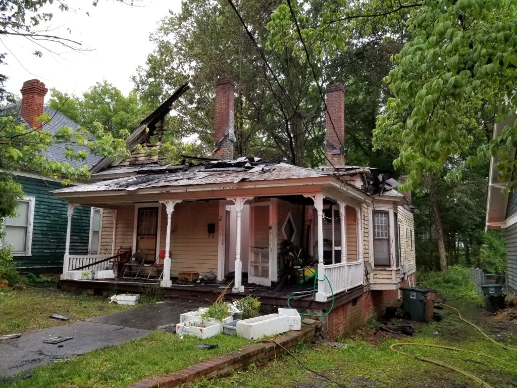 923 Carr Street with its roof burned away after the fire