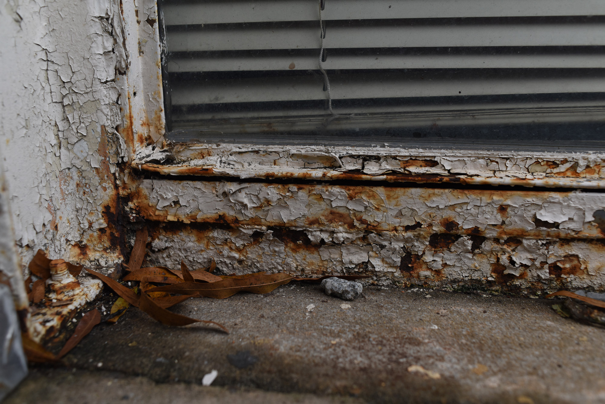 crumbling window frame at a guilford county school
